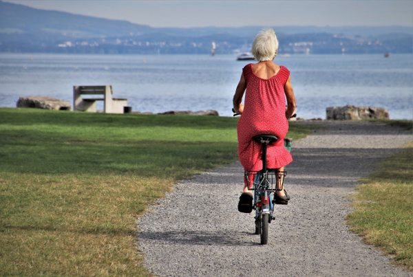 Elderly Woman Riding Bike